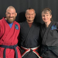 Grandmaster Scot Conway smiles with Joshua and Andrea Loya.