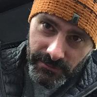 Close-up of Jason James in an orange beanie.