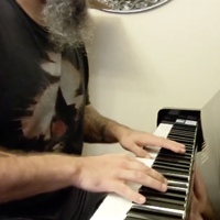 Josh Wolfer's hands shown while playing a keyboard.