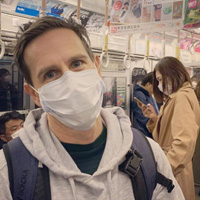Jonesy takes a selfie while wearing a face mask on a Japanese subway.