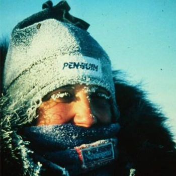 Victoria Humphries wears a winter cap and fur-lined coat which is dusted with snow. Her eyebrows also appear powdered with white snowflakes.
