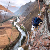 Simone Knego suspended on the side of a mountain beneath her Skylodge in Peru's Sacred Valley.